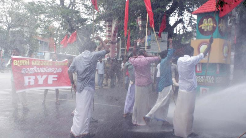 Police uses water cannons on RYF activists during their protest march demanding the ouster of Transport Minister Thomas Chandy in Thiruvananthapuram on Friday.  (Photo: A.V. MUZAFAR)