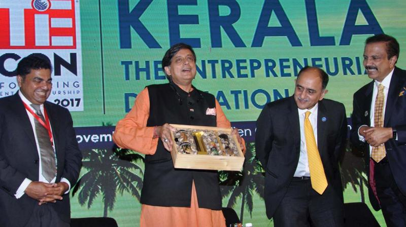 TiE Kerala president Rajesh Nair, Shashi Tharoor, MP, Federal Bank CEO Shyam Srinivasan and Aster DM Healthcare Chairman Azad Moopan at the inauguration of TiE-con Kerala 2017 in Kochi on Friday.  (Photo: SUNOJ NINAN MATHEW)