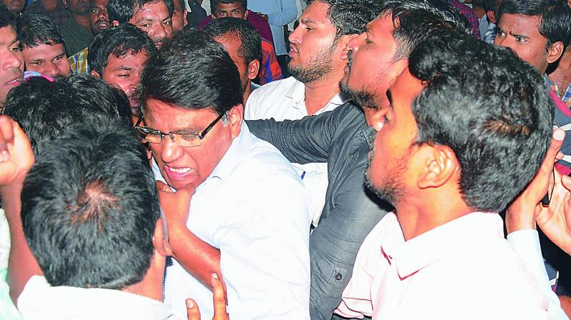 OU vice-chancellor S. Ramachandram being manhandled by students at the Maneru Hostel on the campus. (Photo: Deepak Deshpande)