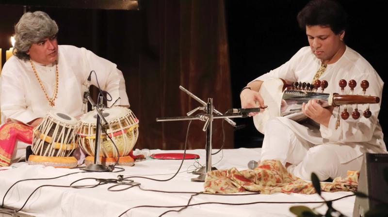 Ram Kumar Mishra (left) and Amaan Ali Khan peform together. (Photo: Inni Singh).