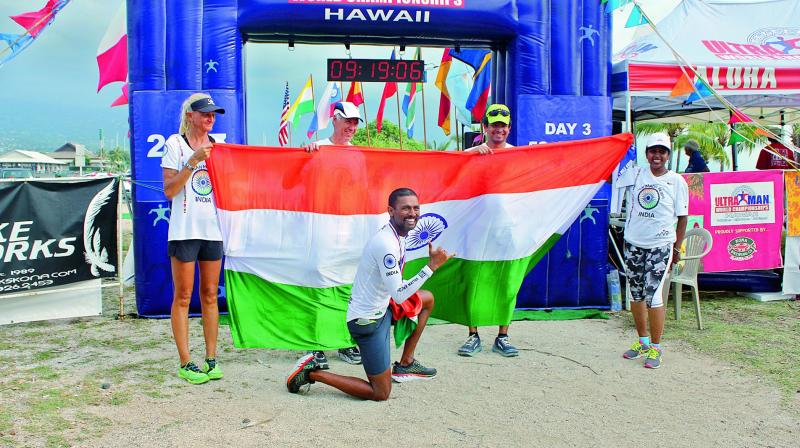 Finishing line: Manmadh poses with the tricolor.