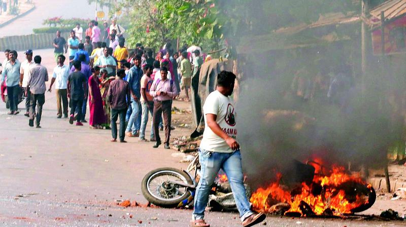 Dalit protesters burn a bike at Vikroli in Mumbai on Wednesday during a protest over Bhima Koregaon violence. (Photo: PTI)