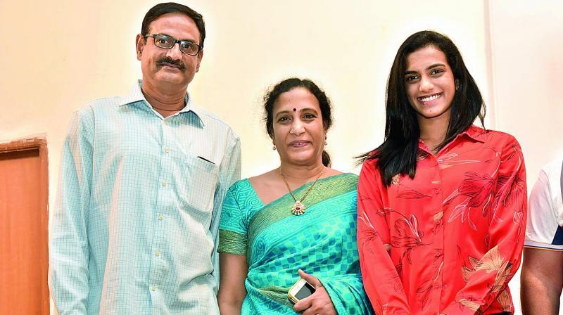 Powerstroke: (top) P.v. Sindhu with her parents P.V. Ramana and P. Vijaya; (right) Nandamuri Balakrishna.