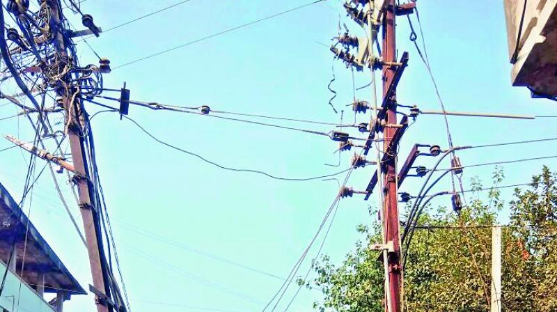 The electric pole slanting towards the road and connected only with wires. (Photo: DC)