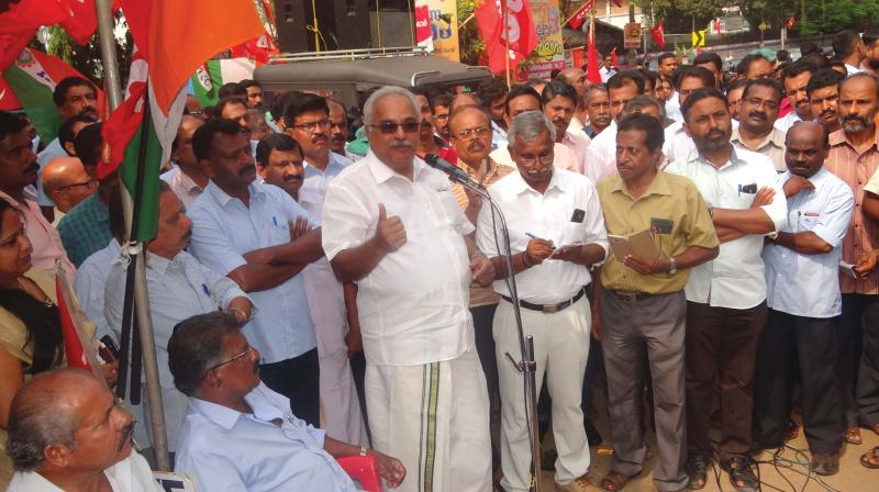 CPI state secretary Kanam Rajendran addresses  protesters in front of HLL Lifecare Limited in  Thiruvananthapuram on Tuesday.