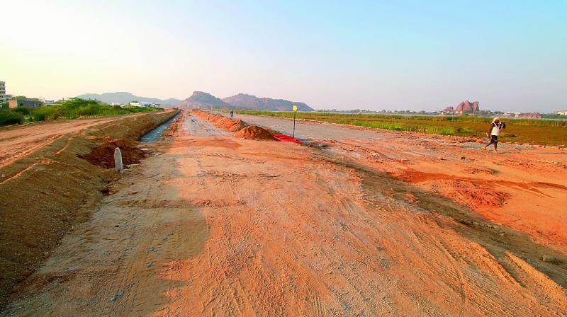 Bund strengthening and road laying work going on at the Bhadrakali tank bund.  (Photo: DC)