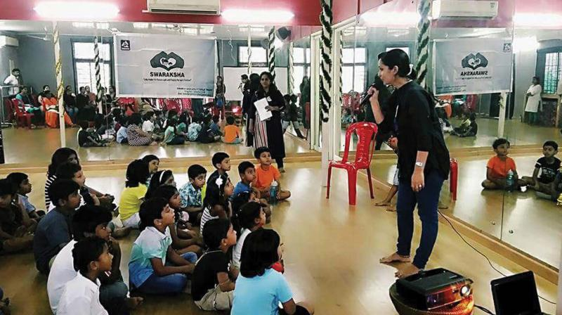 Anu handling a session with children.