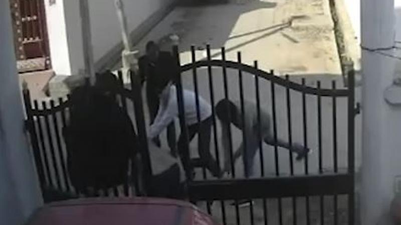 In the video, the victim identified as Abid Ali, a local journalist, is seen being attacked by half a dozen men at the gate of his house. (Photo: Screengrab)