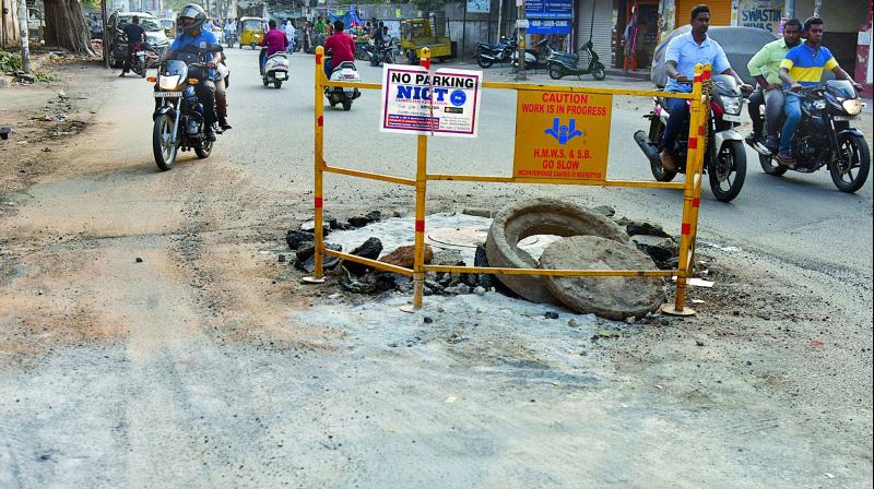 The newly re-carpeted road dug up for laying water pipelines at West Marredpally on Tuesday. (Photo: DC)