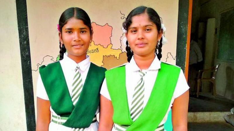 Dynamic duo: Algote Vaishnavi and Rashmita Mothkuri infront of their school.