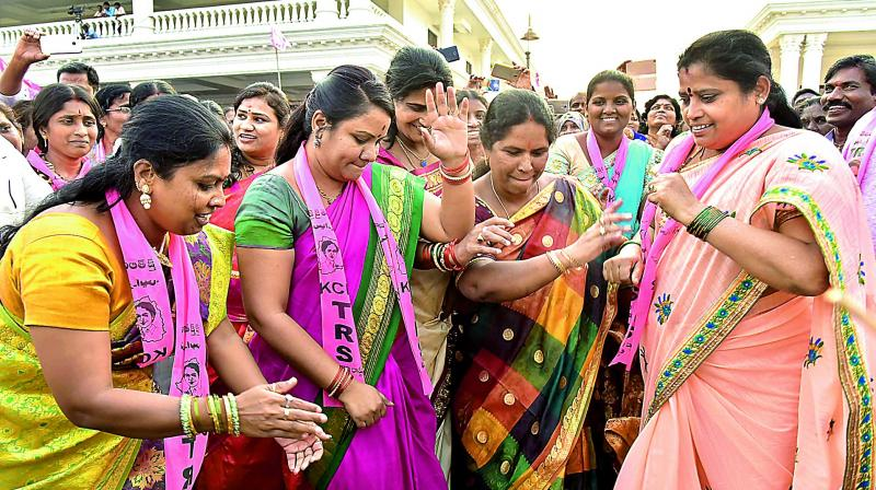 TRS party workers dance at the meet. (Photo: DC)