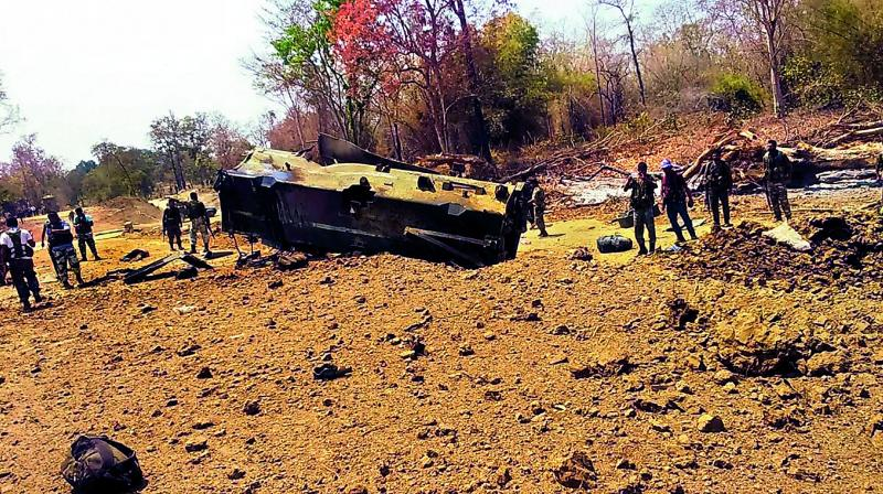 Security personnel inspect the site of an IED blast in Kistaram area of Chhattisgarh's Sukma district on Tuesday. 	— PTI