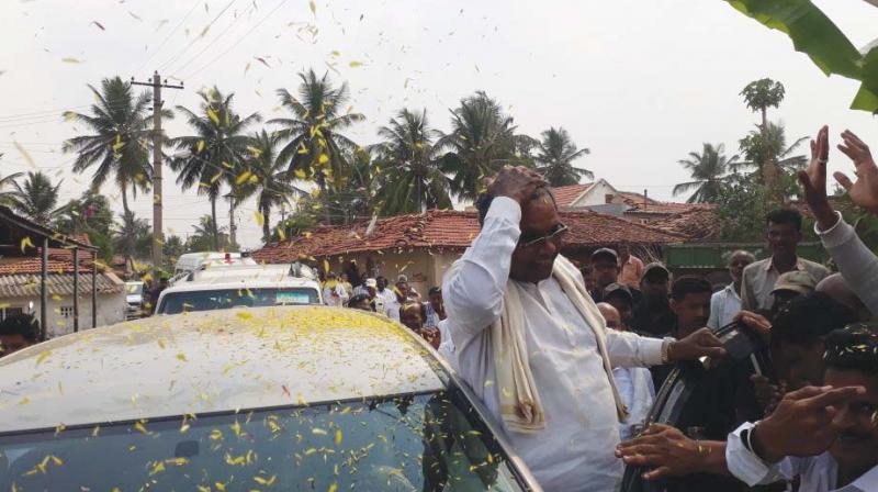 CM Siddaramaiah at a village in Chamundeshwari constituency on Saturday. (Photo: DC)