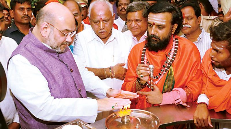 BJP president Amit Shah visits Shivayog Mandar near Badami in Bagalkot on Tuesday