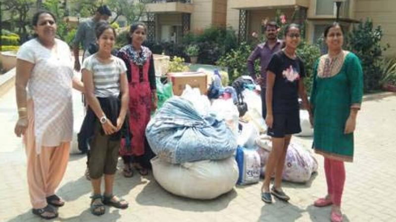People making donations at a collection camp run by Goonj Foundation in the city.