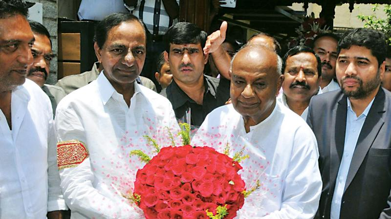 Telangana Chief Minister K. Chandrasekhar Rao with former Prime Minister and JD(S) supremo H.D. Deve Gowda in Bengaluru on Friday. (Photo: File/KPN)