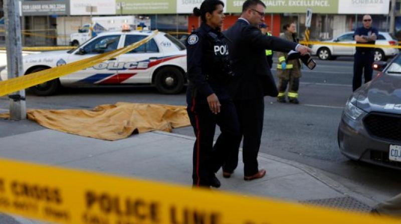Toronto police investigates an incident where an van struck multiple people at a major intersection. (Reuters)