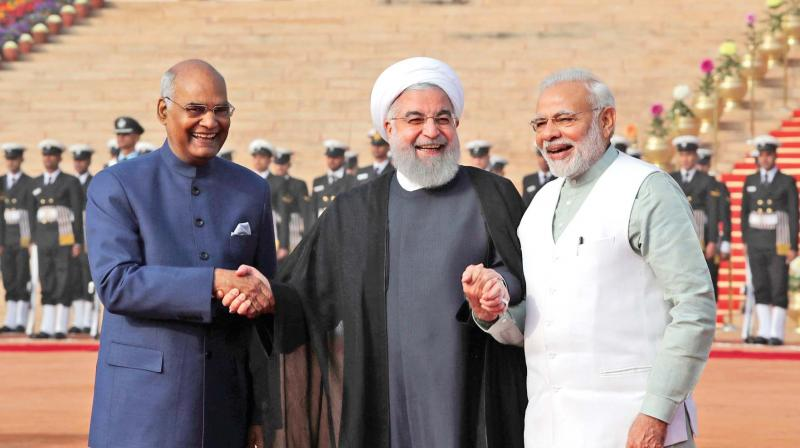 Iranian president Hassan Rouhani holds hands with President Ram Nath Kovind and Prime Minister Narendra Modi at Rashtrapati Bhavan, New Delhi, on February 17.