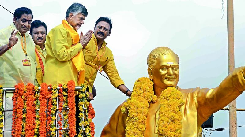 AP Chief Minister N. Chandrababu Naidu garlands the statue of party founder N.T. Rama Rao at Patamata centre before going to Mahanadu in Vijayawada on Monday. (Photo: DC)