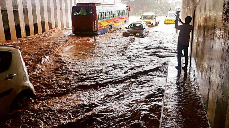 The Padil underpass on the Mangaluru-Bengaluru highway was flooded after rains lashed the port city on Tuesday. (Photo:  DC)