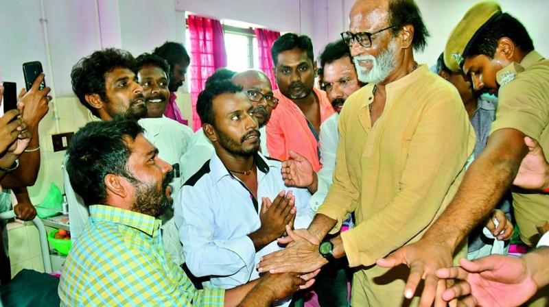 Rajinikanth with an injured person at Thoothukudi government medical college hospital on Wednesday.