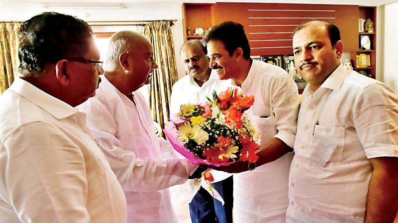AICC general secretary K.C. Venugopal and Dy CM G. Parameshwar call on JD(S) supremo H.D. Deve Gowda in Bengaluru on Friday. (Photo: KPN)