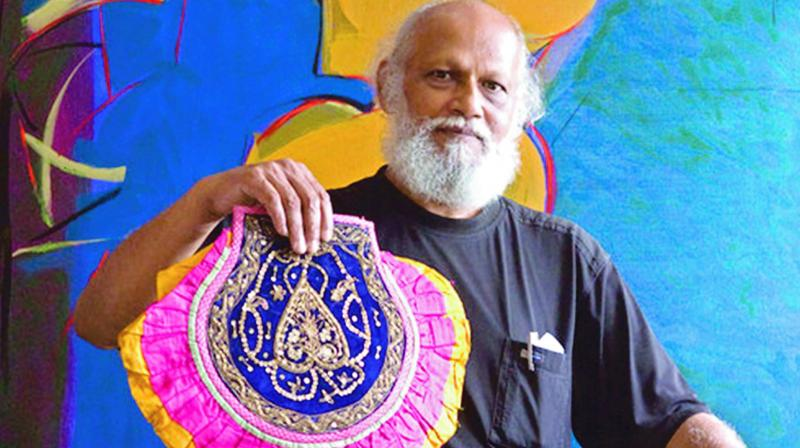 Jatin Das with a fan from his Pankha Collection.