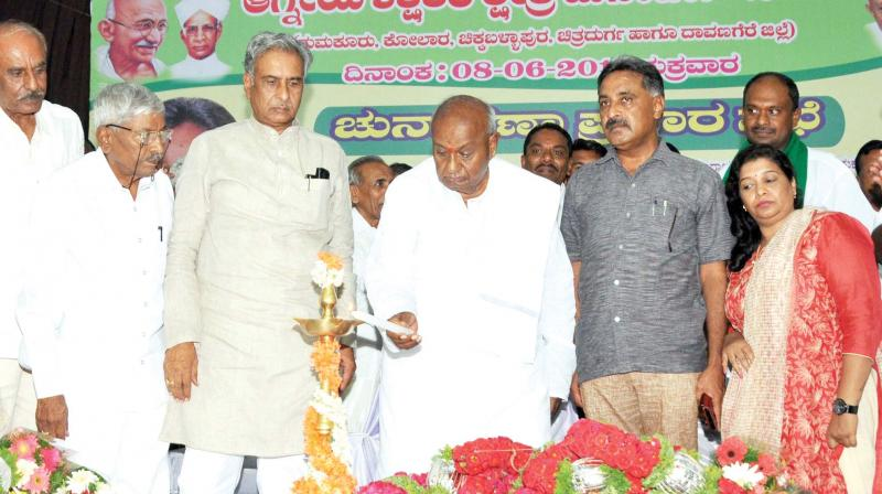 File picture of JD(S) chief HD Deve Gowda with MLCs Ramesh Babu and Basavaraj Horatti. (Photo: KPN)