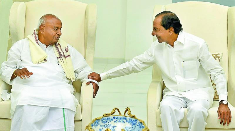Former prime minister H.D. Deve Gowda meets Telangana state Chief Minister K. Chandrasekhar Rao, in Hyderabad on Sunday.