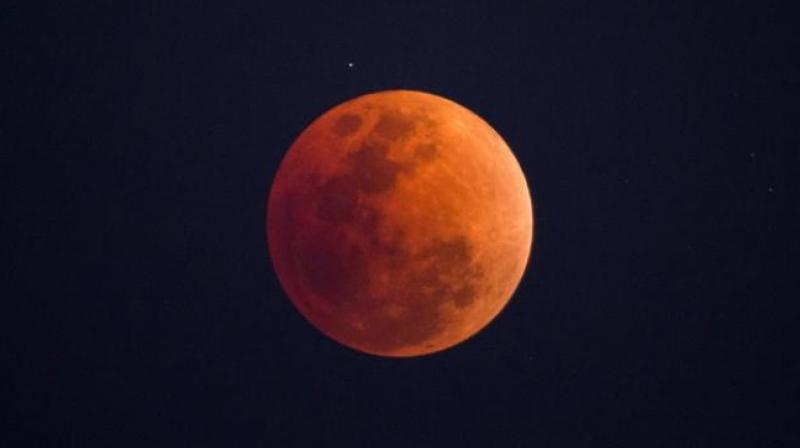 Clouds hinder Delhi's view as skygrazers revel in 'Blood Moon'