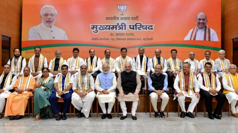 PM Modi, BJP president Amit Shah, senior ministers Rajnath Singh, Nitin Gadkari and Arun Jaitley in a group photograph with the party chief ministers during a day-long meeting of the BJP Chief Ministers' Council in New Delhi on Tuesday. (Photo: Twitter | @BJP4India)
