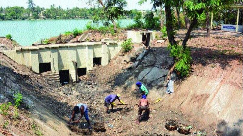 Lake at ICF being cleaned, restored. 	(Photo: DC)