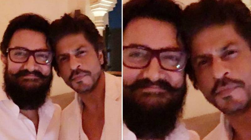 Aamir Khan and Shah Rukh Khan at an event.