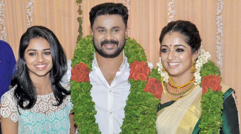 Dileep with daughter Meenakshi and Kavya,