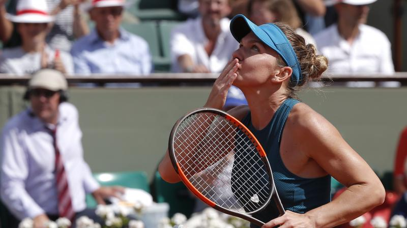 Simone Halep's victory over third seed Muguruza also means she will retain the world number one ranking next week. (Photo: AP))