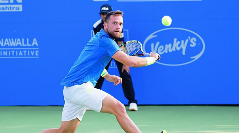 Spain's Ricardo Ojeda Lara in action against Jiri Vesely of the Czech Republic in their Tata Open first round match in Pune on Monday. Lara won 6-3, 7-6.