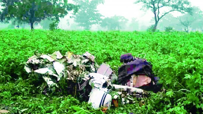 The wreckage of a Cessna trainer aircraft in a cotton field near Sultanpur village in Bantwaram Mandal of Vikarabad district of Telangana, on Sunday.