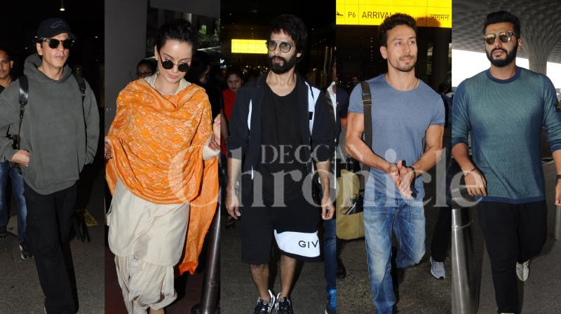 From Shah Rukh Khan, Kangana Ranaut, Arjun Kapoor to Shahid Kapoor, Tiger Shroff, Parineeti Chopra and others, take a look at Bollywood actors whose fashion game is on point even while they travel. (Pictures: Viral Bhayani)
