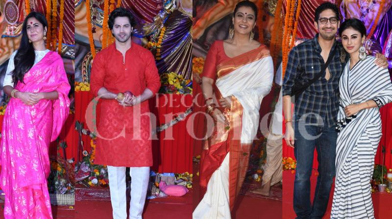 The holy festival Durga Utsav saw a host of B-Town celebrities throng the puja pandals to seek blessings of the goddess. Katrina Kaif, Varun Dhawan, Kajol, Mouni Roy and other Bollywood stars visited puja mandap. Check out these pictures. (Photos: Viral Bhayani)