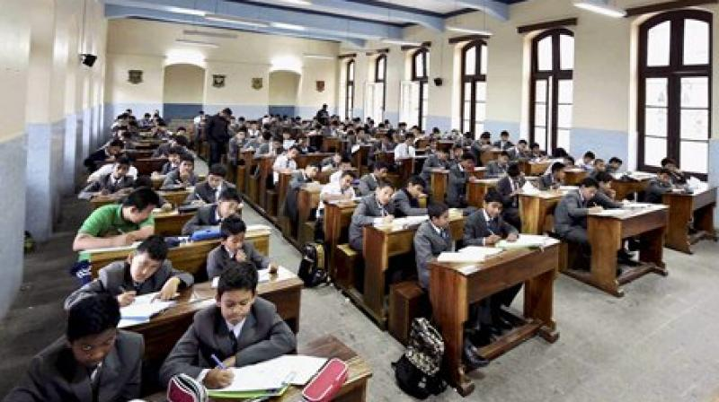 Students of St Josaph North Point school are busy their their examination during GJM called indefinite Bandh at Singhmari in Darjeeling. (Photo: PTI)