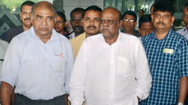 Former Calcutta High Court judge C S Karnan upon his arrival at the airport in Kolkata on Wednesday. (Photo: PTI)