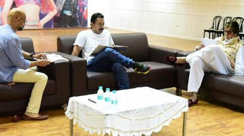 Director Vijay Krishna Acharya, Aamir Khan and Amitabh Bachchan engrossed in a reading session.