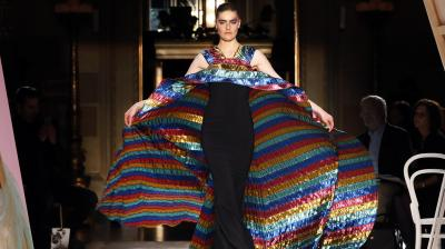 This Christian Siriano dress had a plain black, figure-hugging design with a multi-coloured cape billowing behind it. (Photo: AP)
