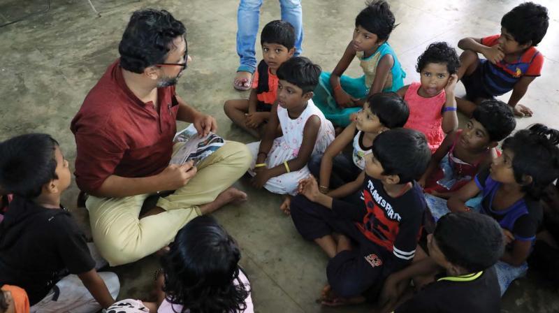 Manu Jose with kids in a relief camp