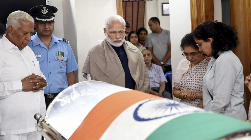 Prime Minister Narendra Modi visited Ananth Kumar's residence at Basavanagudi and paid homage to his colleague by placing a wreath on his mortal remains on Monday night. (Photo: PTI)