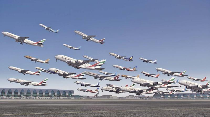 A composite of multiple planes taking off from Dubai airport.