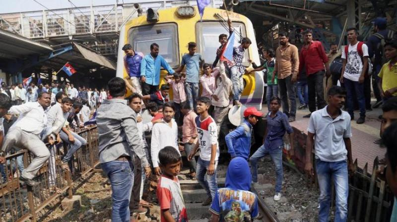 Dalit groups protesting at Thane railway station during the Maharashtra Bandh on Wednesday following clashes between two groups in Bhima Koregaon near Pune in Mumbai