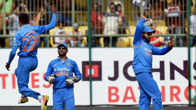 """""""We just have 8 games before Champions Trophy. So we would like to see how he reacts under different conditions and situations,"""" said MS Dhoni as he praised Hardik Pandya. (Photo: PTI)"""
