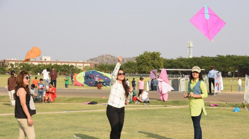 A file photo of women flying kites.