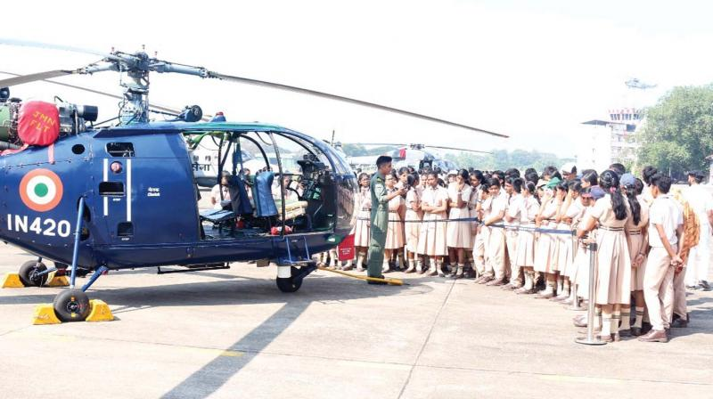Navy personnel interact with school students at the Navy Air Station during their visit to Kochi Naval Base on Wednesday.	(Photo: DC)